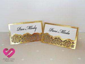 Eleganckie złote winietki weselne ślubne z motywem róż, kwiatów w stylu glamour