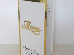 Eleganckie złote menu weselne z motywem kwiatów róż w stylu glamour