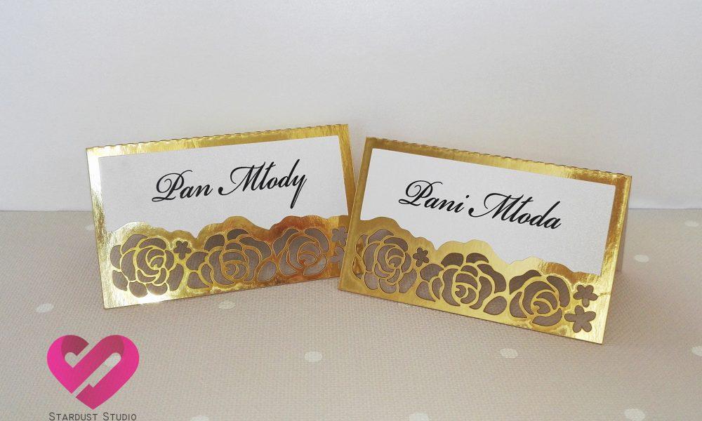 Eleganckie złote winietki ślubne z motywem róż, kwiatów w stylu glamour